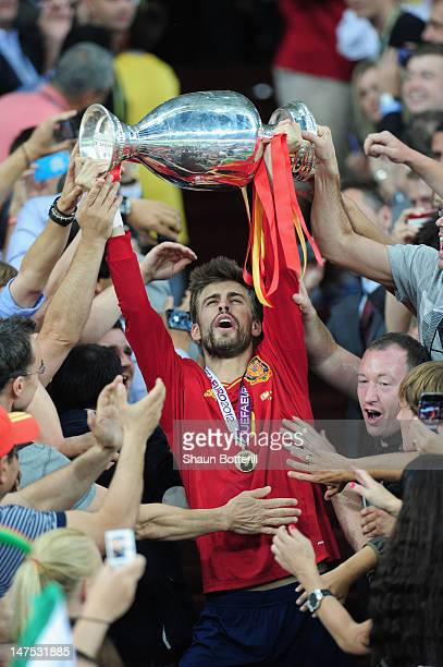 Gerard Pique of Spain celebrates with the trophy after victory during the UEFA EURO 2012 final match between Spain and Italy at the Olympic Stadium...