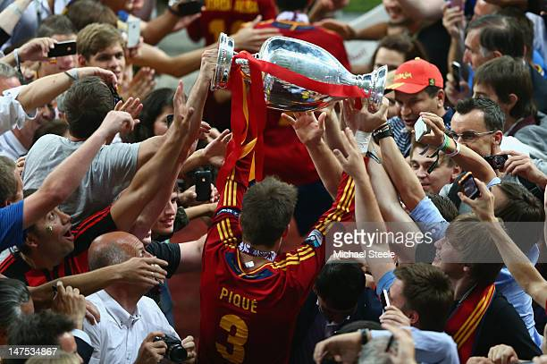 Gerard Pique of Spain celebrates with the trophy during the UEFA EURO 2012 final match between Spain and Italy at the Olympic Stadium on July 1 2012...