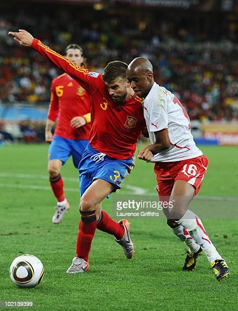 Gerard Pique of Spain clashes with Gelson Fernandes of Switzerland during the 2010 FIFA World Cup South Africa Group H match between Spain and...