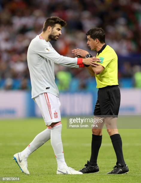 Gerard Pique of Spain confronts referee Andres Cunha during the 2018 FIFA World Cup Russia group B match between Iran and Spain at Kazan Arena on...