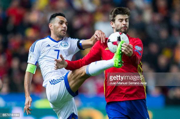 Gerard Pique of Spain duels for the ball with Eran Zahavi of Israel during the FIFA 2018 World Cup Qualifier between Spain and Israel at Estadio El...