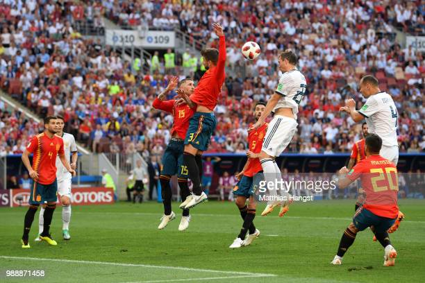 Gerard Pique of Spain handles the ball inside the penalty area leading to a penalty awarded to Russia during the 2018 FIFA World Cup Russia Round of...