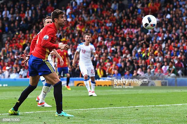 Gerard Pique of Spain heads the ball to score his team's first goal during the UEFA EURO 2016 Group D match between Spain and Czech Republic at...