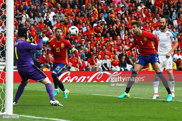 Gerard Pique of Spain heads the ball to score his team's first goal past Petr Cech of Czech Republic during the UEFA EURO 2016 Group D match between...