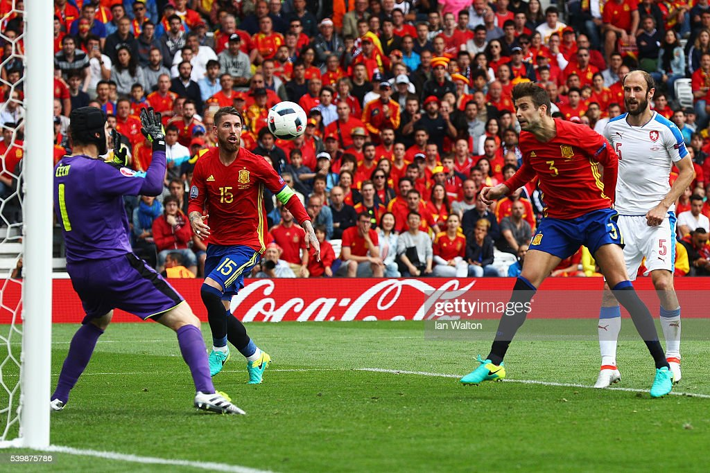 Gerard Pique (2nd R) of Spain heads the ball to score his team's first goal past Petr Cech (1st L) of Czech Republic during the UEFA EURO 2016 Group D match between Spain and Czech Republic at Stadium Municipal on June 13, 2016 in Toulouse, France.
