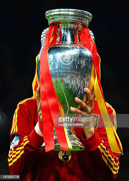 Gerard Pique of Spain kisses the trophy following victory in the UEFA EURO 2012 final match between Spain and Italy at the Olympic Stadium on July 1,...