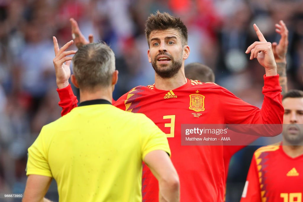 Gerard Pique of Spain reacts to Referee Bjorn Kuipers after he awarded Russia a penalty during the 2018 FIFA World Cup Russia Round of 16 match between Spain and Russia at Luzhniki Stadium on July 1, 2018 in Moscow, Russia.