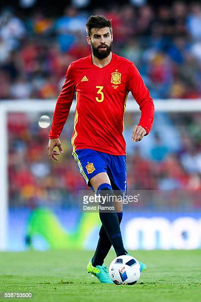 Gerard Pique of Spain runs with the ball during an international friendly match between Spain and Georgia at Alfonso Perez stadium on June 7 2016 in...