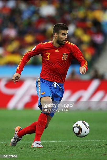 Gerard Pique of Spain runs with the ball during the 2010 FIFA World Cup South Africa Group H match between Spain and Switzerland at Durban Stadium on...
