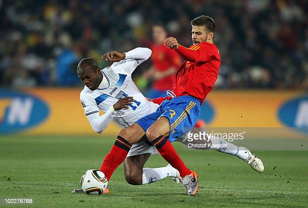 Gerard Pique of Spain tackles David Suazo of Honduras during the 2010 FIFA World Cup South Africa Group H match between Spain and Honduras at Ellis...