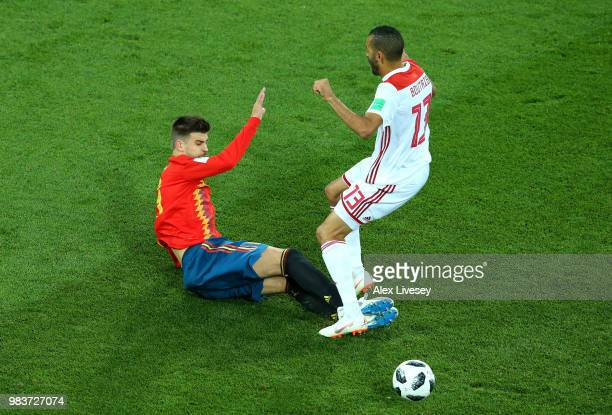 Gerard Pique of Spain tackles Khalid Boutaib of Morocco during the 2018 FIFA World Cup Russia group B match between Spain and Morocco at Kaliningrad...