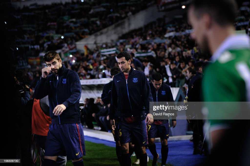 Gerard Pique (L), Sergio Busquets (C) and Pedro Rodriguez of FC Barcelona enter the pitch prior to the La Liga match between Real Betis Balompie and FC Barcelona at Estadio Benito Villamarin on December 9, 2012 in Seville, Spain.