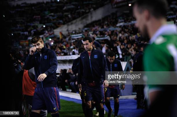 Gerard Pique Sergio Busquets and Pedro Rodriguez of FC Barcelona enter the pitch prior to the La Liga match between Real Betis Balompie and FC...