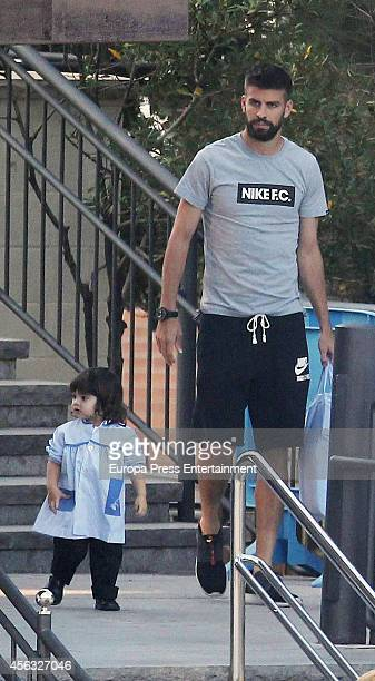 Gerard Pique takes his son Milan to school on September 29 2014 in Barcelona Spain