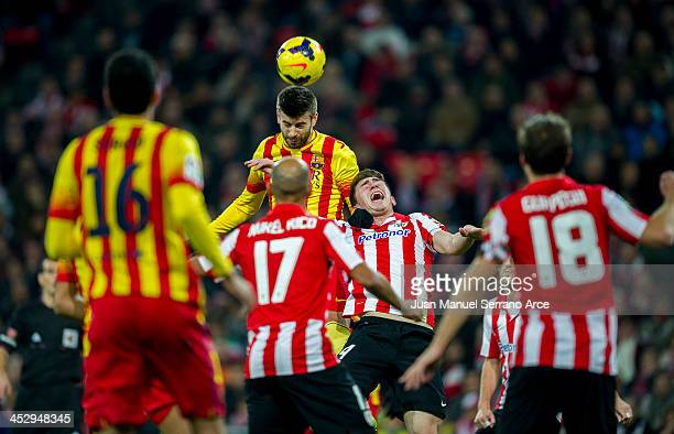 Gerard Piqueof FC Barcelona duels for the ball with Aymeric Laporte of Athletic Club during the La Liga match between Athletic Club and FC Barcelona...