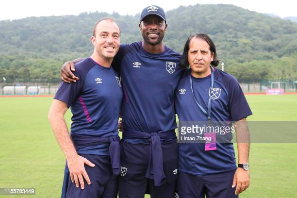 Gerard Prendeville, former West Ham player Carlton Cole and Rashid Abba of West Ham, Marc McLaren of Wolves taking a photo with the Premier League...