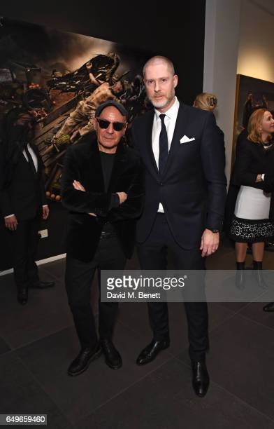 Gerard Rancinan and JeanDavid Malat attend a private view of artist Gerard Rancinan's new exhibition 'The Destiny Of Men' at Opera Gallery on March 8...