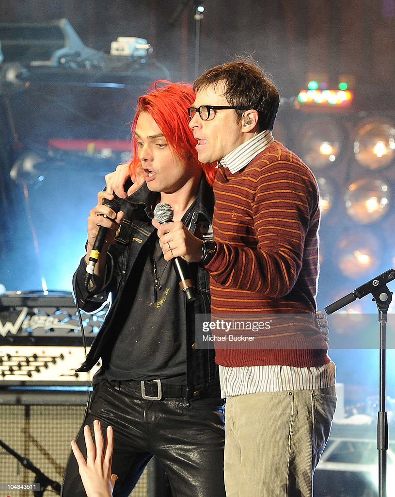 Gerard Way of My Chemical Romance (L) and Rivers Cuomo of Weezerperform at the 'AXE Music One Night Only' concert series featuring Weezer at Dunes Inn Motel - Sunset on September 21, 2010 in Hollywood, California.