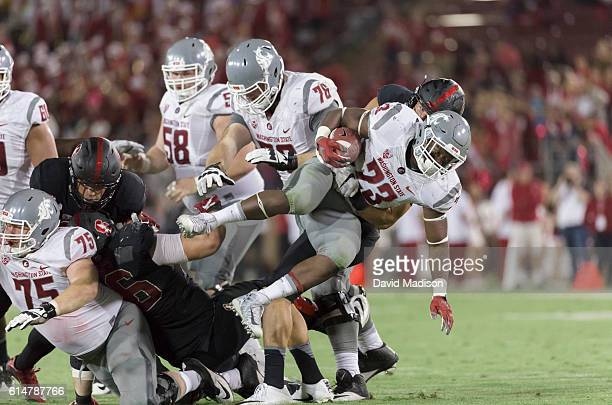 Gerard Wicks of the Washington State Cougars is tackled by Mike Tyler of the Stanford Cardinal during a kick return in an NCAA Pac12 football game...