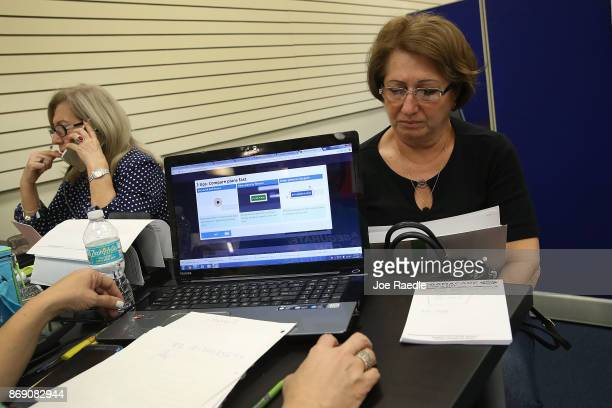 Gerardina de la Mercedes and Elena Blondin speak with insurance agents from Sunshine Life and Health Advisors as they shop for insurance under the...