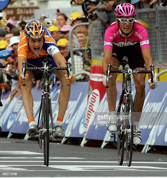 Dutch Pieter Weening and German Andreas Kloden cross the finish line of the eighth stage of the 92nd Tour de France cycling race between Pforzheim...