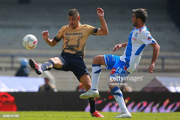 Gerardo Alcoba of Pumas struggles for the ball with Alvaro Navarro of Puebla during the 3rd round match between Pumas UNAM and Puebla as part of the...