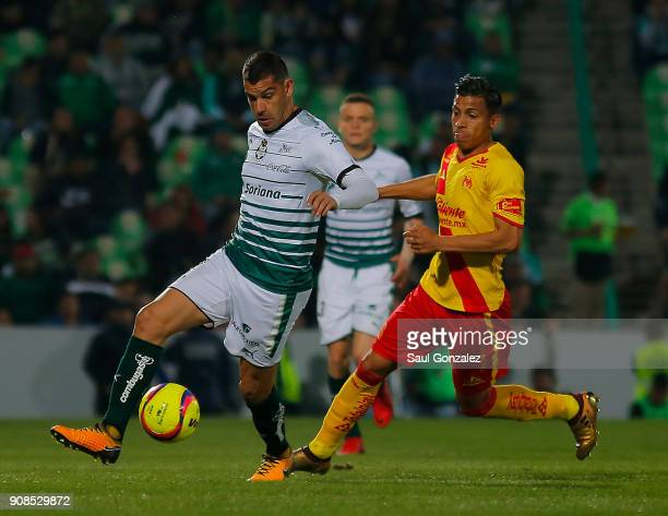 Gerardo Alcoba of Santos and Angel Sepulveda of Morelia fight for the ball during the 3rd round match between Santos Laguna and Morelia as part of...