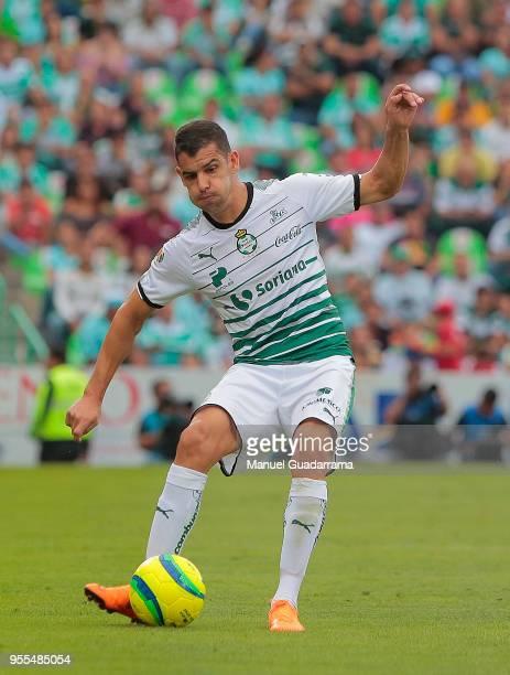 Gerardo Alcoba of Santos passes the ball during the quarter finals second leg match between Santos Laguna and Tigres UANL as part of the Torneo...