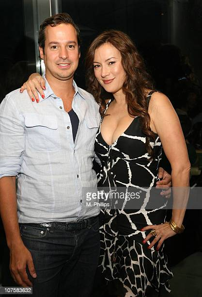 Gerardo Figueroa and Jennifer Tilly during GQ / Calvin Klein Celebrity Poker Tournament Benefiting Peace Games - Calvin Klein Gift Lounge at Private...