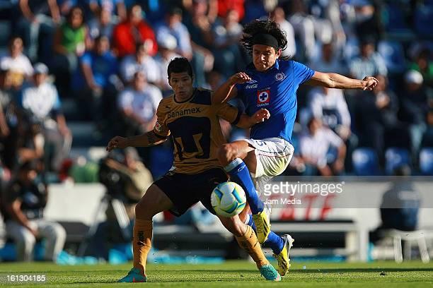 Gerardo Flores of Cruz Azul struggles for the ball with Robin Ramirez of Pumas during the match between Cruz Azul and Pumas as part of the Clausura...