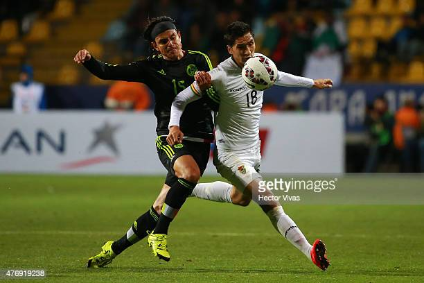 Gerardo Flores of Mexico fights for the ball with Ricardo Pedriel of Bolivia during the 2015 Copa America Chile Group A match between Mexico and...