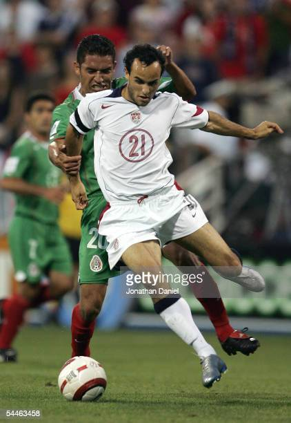 Gerardo Galindo of Mexico tackles Landon Donovan of the USA during the their 2006 World Cup Qualifying match at Crew Stadium on September 3 2005 in...