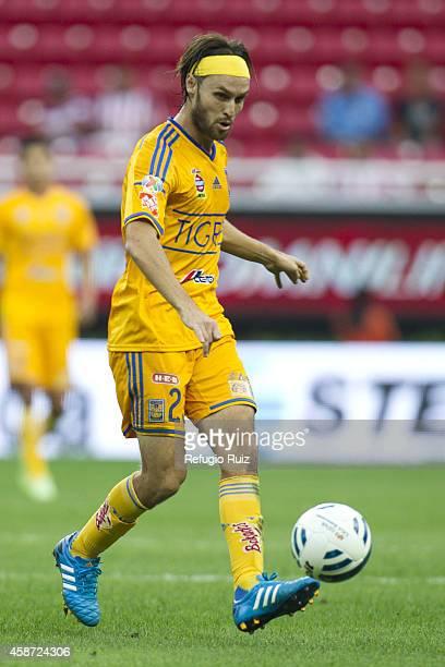 Gerardo Lugo of Tigres drives the ball during a match between Chivas and Tigres UANL as part of 16th round Apertura 2014 Liga MX at Omnilife Stadium...