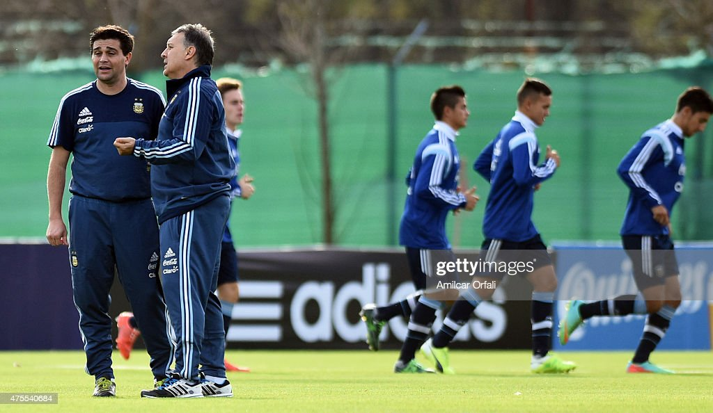 Gerardo Martino coach of Argentina talks with an assistant during a training session at Argentine Football Association 'Julio Humberto Grondona' training camp on June 01, 2015 in Ezeiza, Argentina. Argentina will face its first match as part of Copa America Chile 2015 against Paraguay on June 13th, 2015.