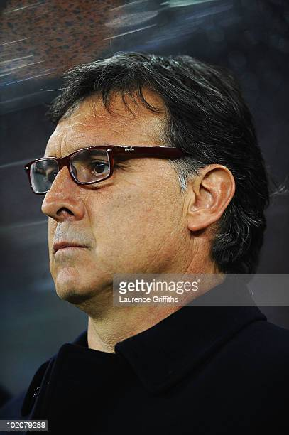 Gerardo Martino head coach of Paraguay looks on prior to the 2010 FIFA World Cup South Africa Group F match between Italy and Paraguay at Green Point...
