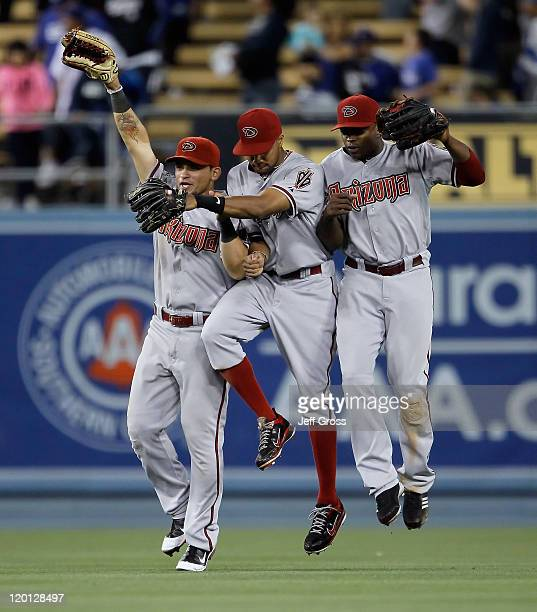 Gerardo Parra Chris Young and Justin Upton of the Arizona Diamondbacks celebrate their teams 64 victory over the Los Angeles Dodgers at Dodger...