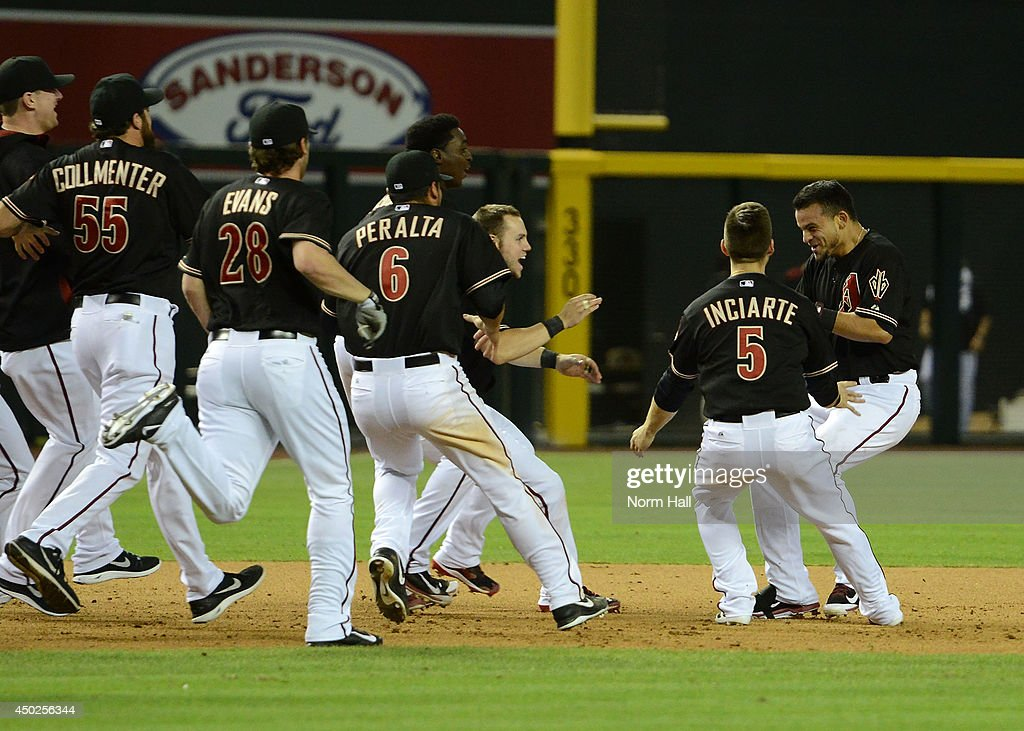 Gerardo Parra #8 of the Arizona Diamondbacks is greeted by teammates after getting the game winning hit in the 11th inning against the Atlanta Braves at Chase Field on June 7, 2014 in Phoenix, Arizona.