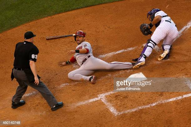 Gerardo Parra of the Arizona Diamondbacks is tagged out by catcher Wilin Rosario of the Colorado Rockies for the third out of the fourth inning as...
