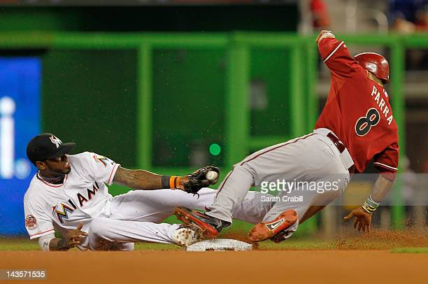Gerardo Parra of the Arizona Diamondbacks slides safely into second before the tag of Jose Reyes of the Miami Marlins during a game at Marlins Park...