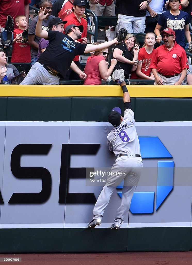 Gerardo Parra #8 of the Colorado Rockies attempts to make a leaping catch at the right field wall on a first inning home run by Brandon Drury #27 of the Arizona Diamondbacks at Chase Field on May 01, 2016 in Phoenix, Arizona.