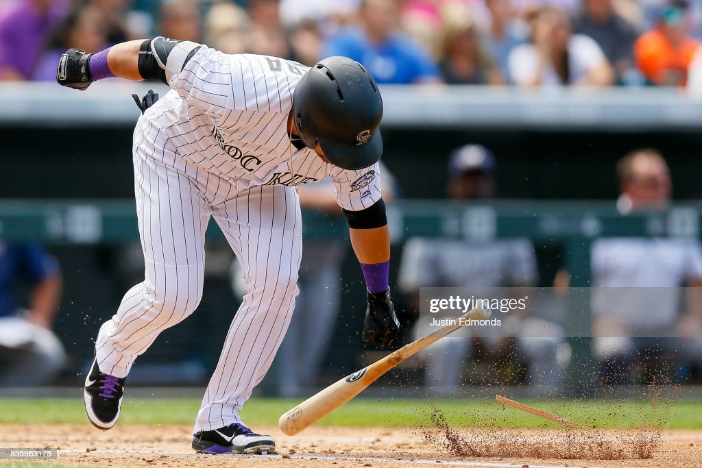Gerardo Parra #8 of the Colorado Rockies breaks his bat after flying out during the third inning against the Milwaukee Brewers at Coors Field on August 20, 2017 in Denver, Colorado.