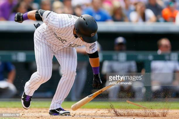 Gerardo Parra of the Colorado Rockies breaks his bat after flying out during the third inning against the Milwaukee Brewers at Coors Field on August...
