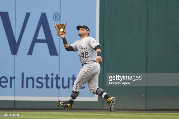 Gerardo Parra of the Colorado Rockies catches a fly ball during a baseball game against the Washington Nationals at Nationals Park on April 15 2018...