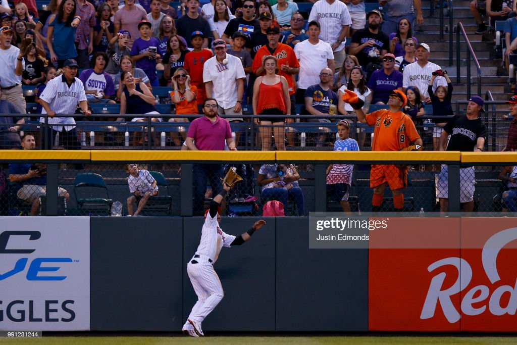 Gerardo Parra #8 of the Colorado Rockies catches a fly ball on the warning track for the second out of the seventh inning against the San Francisco Giants at Coors Field on July 3, 2018 in Denver, Colorado.