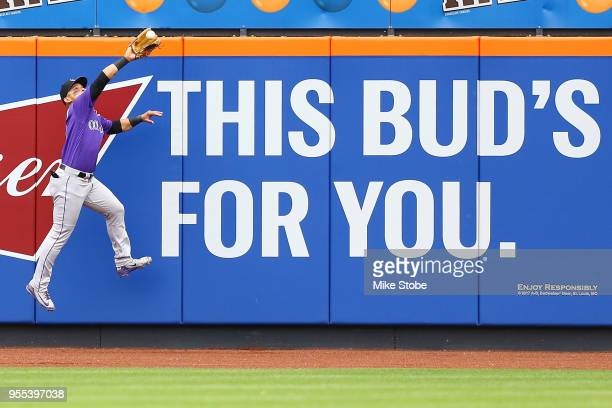 Gerardo Parra of the Colorado Rockies makes a leaping catch off the bat of Asdrubal Cabrera of the New York Mets in the sixth inning at Citi Field on...