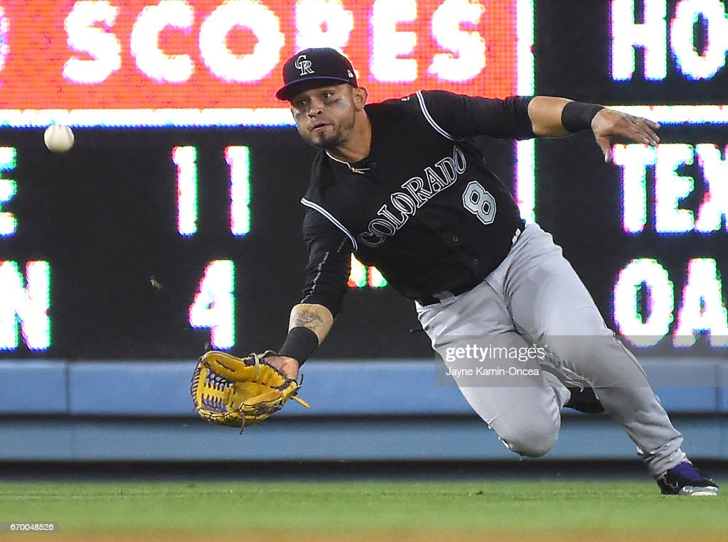Gerardo Parra #8 of the Colorado Rockies reaches for a single hit by Corey Seager #5 of the Los Angeles Dodgers in the ninth inning of the game at Dodger Stadium on April 18, 2017 in Los Angeles, California. Rockies won 4-3.