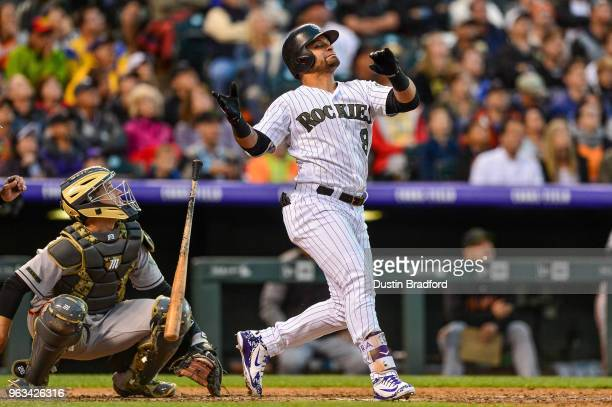 Gerardo Parra of the Colorado Rockies reacts after popping out to end the sixth inning of a game against the San Francisco Giants at Coors Field on...