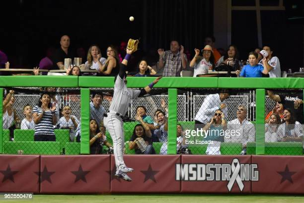 Gerardo Parra of the Colorado Rockies robs JT Realmuto of the Miami Marlins of a home run in the seventh inning of the game at Marlins Park on April...