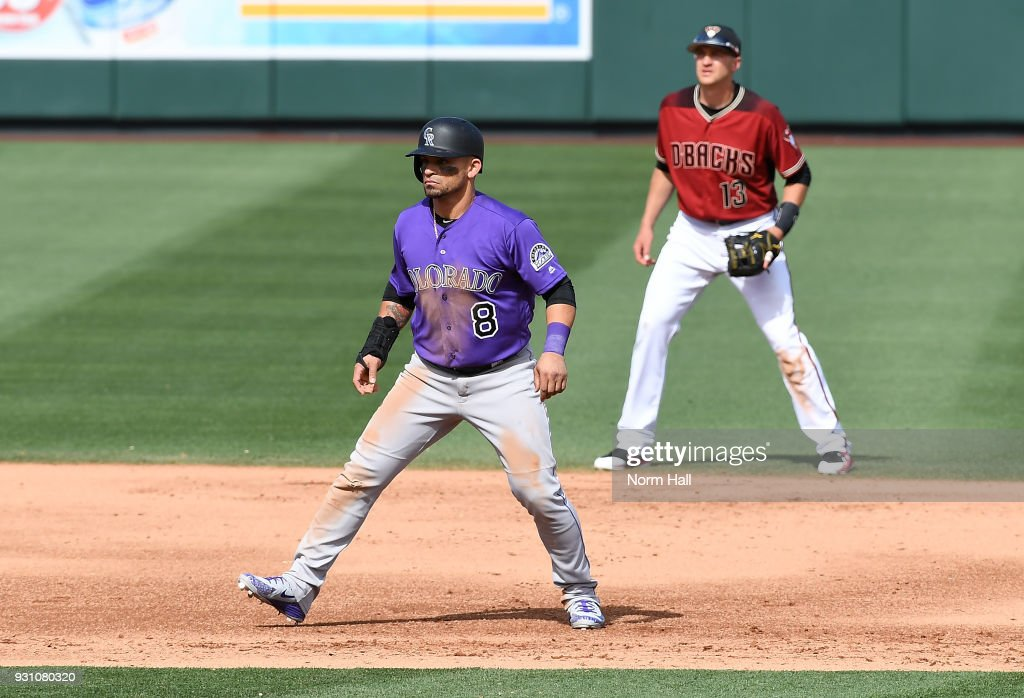 Gerardo Parra #8 of the Colorado Rockies takes a lead from second base as Nick Ahmed #13 of the Arizona Diamondbacks gets ready to make a play during the fifth inning of a spring training game at Salt River Fields at Talking Stick on March 12, 2018 in Scottsdale, Arizona.