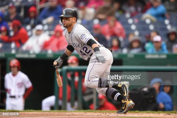 Gerardo Parra of the Colorado Rockies takes a swing during a baseball game against the Washington Nationals at Nationals Park on April 15 2018 in...